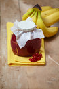 Banana and red berry jam jar of Royalty Free Stock Images