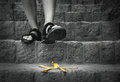 Banana`s peel is on the stairs - traveler can steps on it Royalty Free Stock Photo