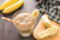 Banana smoothie on wooden background. Top view Royalty Free Stock Photo