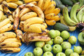Bananas and Limes at Outdoor Market Royalty Free Stock Photo