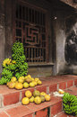 Bananas and pomelo fruit in selling these fruits are front of the farmers house Royalty Free Stock Photos