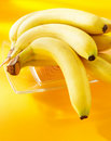 Bananas on a yellow background Stock Images