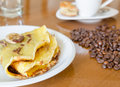 Bananna pancakes breakfast with and coffee Stock Images