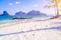 Banca boat on Ipil beach in evening sunlight on Inabuyatan Island, El Nido, Palawan, Philippines Royalty Free Stock Photo