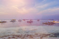Banca boats anchored in the lagoon at Panglao Island in evening light. Bohol, Philippines