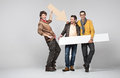 A band of male friends with signs Royalty Free Stock Photography