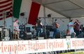 A band performs on stage at the memphis italian festival sign is weekend long event held annually in tennessee first weekend in Stock Images
