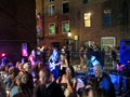 Band plays outside at bar in the old port portland maine may s cover as people dance to music portland maine may Royalty Free Stock Photo