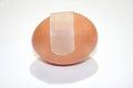Bandage on the egg white background Stock Image