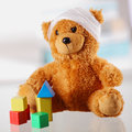 Bandaged Classic Teddy Bear with Various Shapes Royalty Free Stock Photo