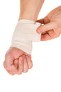 Bandaging the hand with an elastic bandage isolated on white background Royalty Free Stock Image