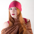 Bandanna and gold fabric a portrait of a pretty woman wearing a red wrapped in shiny copper colored Stock Photos