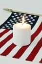 Bandera americana y una vela Fotos de archivo