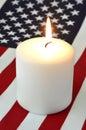 Bandera americana y una vela Fotografía de archivo