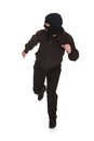 Bandit in black mask running away man wearing over white background Royalty Free Stock Photo