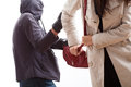Bandit snatching a purse from young woman Stock Photography