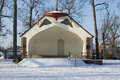 Bandshell in winter no concert this weekend at the local park band shell too much snow and cold a very retro park building for the Royalty Free Stock Image