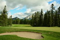 Banff golf course is one of the prettiest places to slice a ball with the rocky mountains surrounding to wildlife holding up your Stock Photography