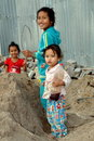 Bang Saen, Thailand: Little Girls Playing in Sand Pile Royalty Free Stock Photo