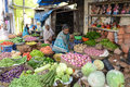Bangalore india in january vendor sells produce on an unnamed street in in january in of falls below the Stock Photo