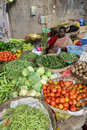 Bangalore india in january vendor sells produce on an unnamed street in in january in of falls below the Royalty Free Stock Photo
