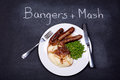 Bangers and mash chalkboard advertising the daily special of Royalty Free Stock Photo