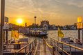 Bangkok city river port thailand march tourist boat arrives in the at sunset Royalty Free Stock Photo