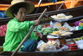 Bangkok floating market in thailand asia boats piled high with tropical fruit and vegetables fresh ready to drink coconut juice Royalty Free Stock Images