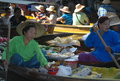 Bangkok floating market in thailand asia boats piled high with tropical fruit and vegetables fresh ready to drink coconut juice Royalty Free Stock Photos