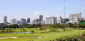 Bangkok golf course in the center of in the middle of the commercial district is a it is surrounded by the towers and skyscrapers Royalty Free Stock Photography