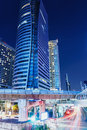 Bangkok at night with autos lights from business area in thailand Stock Photos