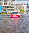 Bangkok-Nov 08 : Taxi drives in water flood road Royalty Free Stock Image
