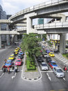 Bangkok october cars and taxis queue at busy intersection underneath mrt lines on october in bangkok thailand Stock Photography