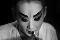BANGKOK - OCTOBER 16: A Chinese opera actress painting mask on her face before the performance at backstage at major shrine in Ban Royalty Free Stock Photo