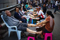 Bangkok shutdown thai anti government protesters getting a foot massage on saladaeng intersection thailand on january Stock Image