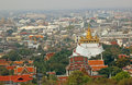 Bangkok skyline temple wat phra kaew emerald buddha sri rattana foreground royal palace Royalty Free Stock Photo
