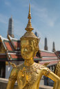 Bangkok, Thailand - April 21, 2015: Golden Kinnari statue outside Buddhist temple in Bangkok's Grand Palace complex, Thailand. Royalty Free Stock Photo