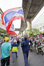Bangkok thailand december neighborhood at sukhumvit holds flag for anti government the protest against the amnesty bill in capital Stock Images