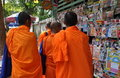 Bangkok, Thailand: Four Monks in Orange Robes Stock Photos