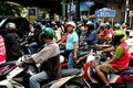 Bangkok, Thailand: Helmeted Motorcyclists Royalty Free Stock Image