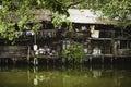 Bangkok thailand jan riverside slums in chao phraya river on january bangkok thailand Royalty Free Stock Photography