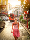 BANGKOK, Thailand - July 31: The China Town at Yaowarat Road. Young woman walking down the street, Thailand on July  31, 2010. Royalty Free Stock Photo