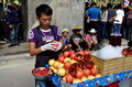 Bangkok thailand man selling pomegranate juice on street vendor freshly squeezed sukhamvit road in Stock Photo