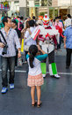 Bangkok thailand march a young girl is photographing a gundam cosplayer at the thai japan anime festival on march Royalty Free Stock Images