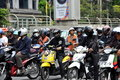 Bangkok, Thailand: Motorcyclists at Traffic Light Stock Images