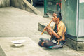Bangkok thailand nov poor man earns his living with music on the street Royalty Free Stock Image