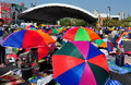Bangkok thailand operation shut down bangkok protestors colourful umbrellas shade from the hot sun at the victory monument during Royalty Free Stock Images