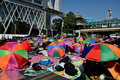 Bangkok thailand operation shut down bangkok protestors colourful umbrellas shade thais sitting on thanon ratchaprasong next to Stock Photography