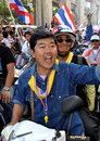 Bangkok thailand operation shut down bangkok protestors exuberant thai man riding on a motorcycle during the anti government Royalty Free Stock Photo