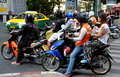 Bangkok, Thailand: People on Motorcycles Royalty Free Stock Photography